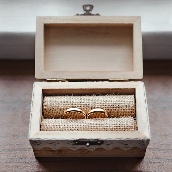 A ring box showing off a pair of wedding bands.